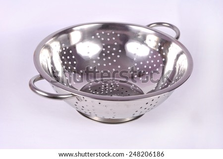 Stainless steel colander - stock photo