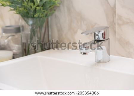 Stainless steel faucet Sink White - stock photo