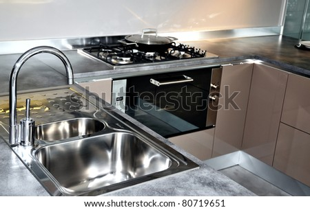 Stainless steel kitchen faucet and sink. Modern kitchen interior
