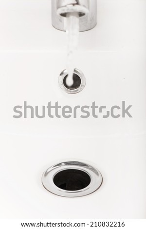stainless steel kitchen sink drain. Bathroom interior with white sink and silver faucet - stock photo