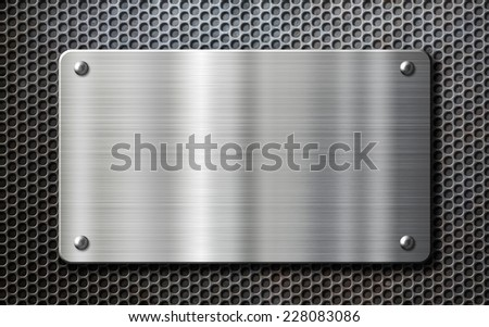 stainless steel metal plate over perforated background - stock photo