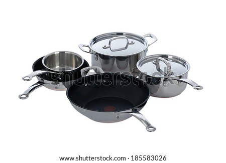Stainless steel pots and pans isolated on white - stock photo