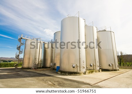 Stainless steel reservoirs for wine in Italy - stock photo