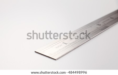 stainless steel ruler on the white background