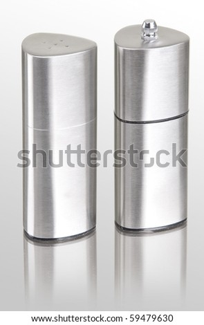 stainless steel salt cellar and pepperbox on white