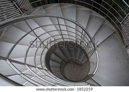 stainless steel stairs in garden - stock photo