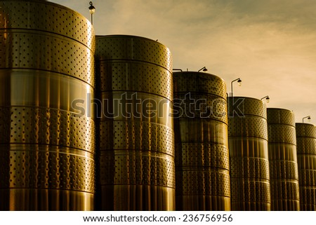 stainless steel storage at sunset - stock photo