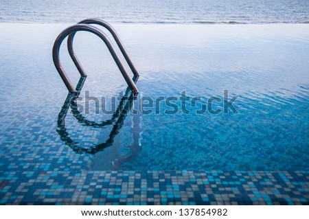 stair in to the pool - stock photo