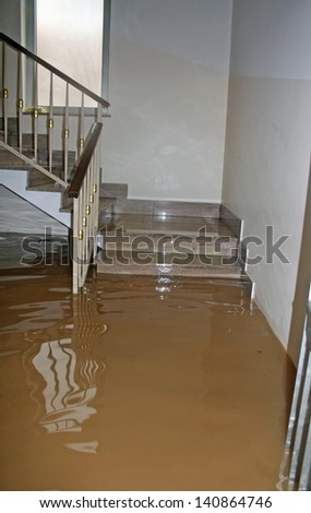 stair of a House fully flooded during the flooding of the river - stock photo