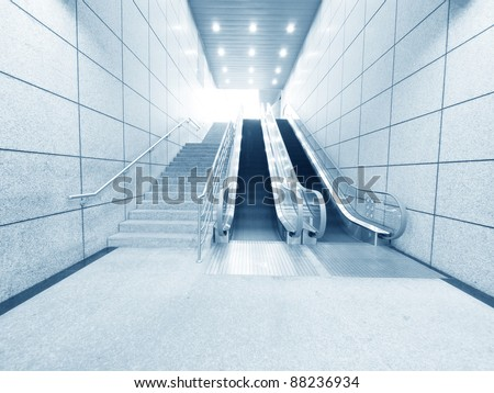 Staircase and escalator in underground - stock photo