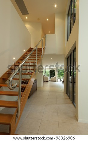 Staircase and hallway in luxurious house - stock photo