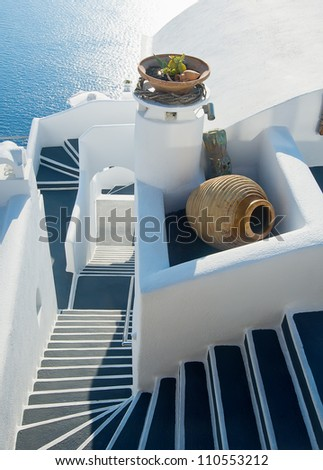 Staircase between the terraces of Firostefani, Santorini at sunset, Greece - stock photo
