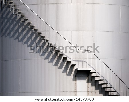 Staircase Going Up a Large Circular Tank - stock photo
