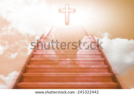 staircase going up to the christian cross,orange color tone - stock photo