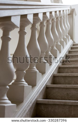 staircase of marble with decorative elements in soft natural light, selective focus, as backdrop for point of stage design. - stock photo