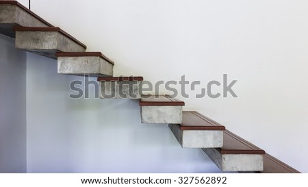 staircase on white mortar wall, design of modern home - stock photo