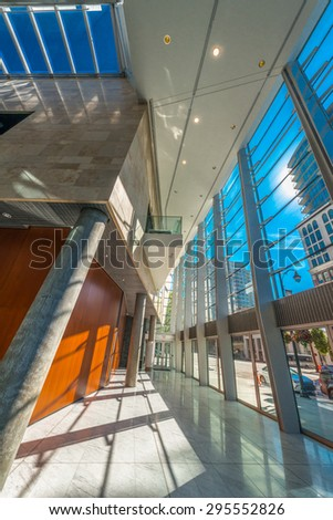 Staircase painted in red. Abstract fragment of urban architecture of modern luxury building, center, hotel, shopping mall, business centre.   Interior design. Vertical. - stock photo