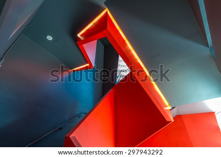 Staircase painted in red. Abstract fragment of urban architecture of modern luxury building, center, hotel, shopping mall, business centre.   Interior design.