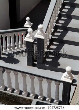 Staircase with white and gray balustrade