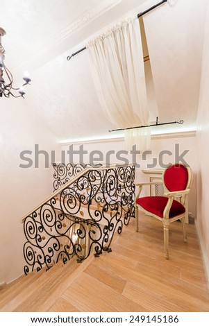 Staircase with wrought iron railings in luxury home interior - stock photo