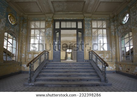 stairs and entrance into old abandoned hospital, germany, beelitz - stock photo