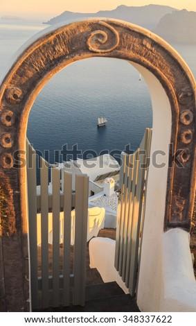 stairs and gate against volcano caldera, beautiful details of Santorini island, Greece - stock photo