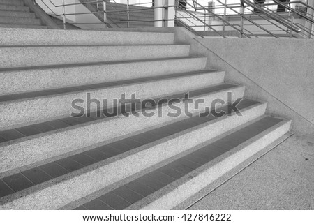 stairs and railing of a modern building, monochrome - stock photo