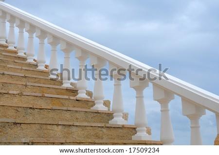 Stairs and white balustrade - stock photo