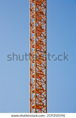 Stairs crane and a cloudless sky - stock photo