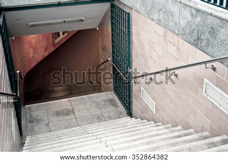 Stairs down to an undeground train station in Berlin, Germany - stock photo