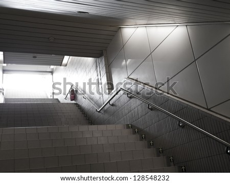 stairs From underground passage with many steps - stock photo