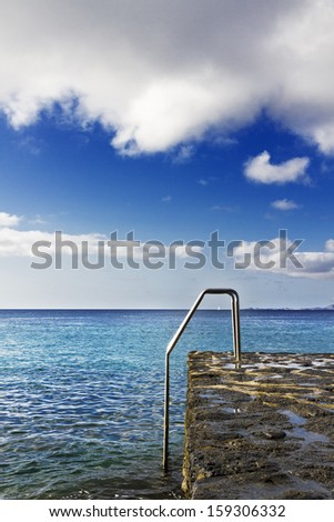 Stairs in Playa Blanca beach, Lanzarote (Spain) - stock photo