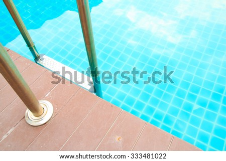Stairs in swimming pool in summer - stock photo