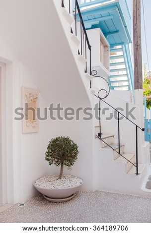 Stairs in the narrow streets of European towns - decorated with flowers. - stock photo