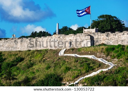 stairs in the old fort with the flag - stock photo
