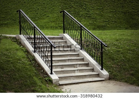 stairs in the park on a green background - stock photo