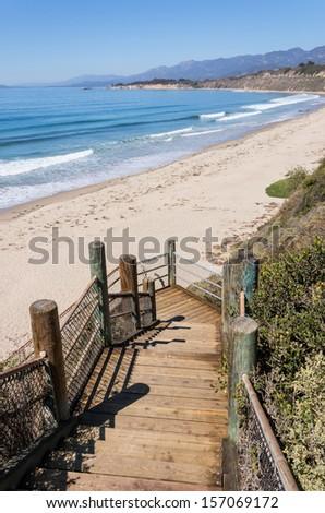 Stairs leading down to the beach and Pacific ocean near Santa Barbara, California. A coastal scene photographed at Rincon Park. - stock photo