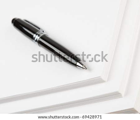 Stairs of paper and black pen - stock photo
