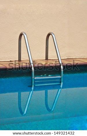 Stairs of the empty swimming pool with reflect - stock photo