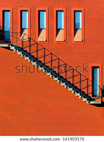 Stairs on the Red Wall - stock photo