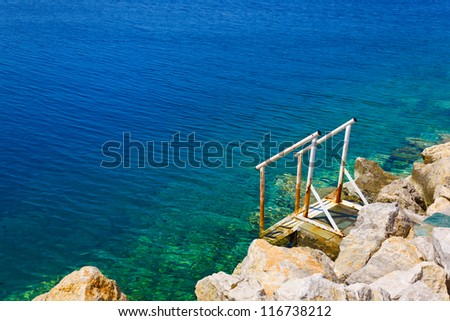 Stairs to sea - vacation beach background