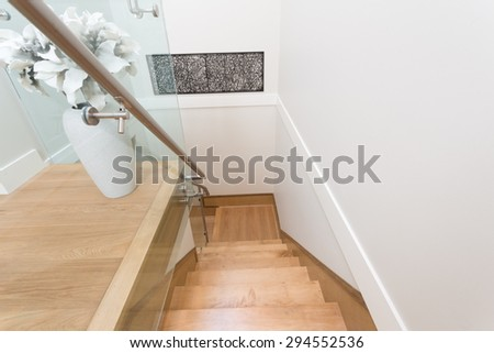 Stairs to the second floor in a luxury house with a flower vase, decoration. Interior design. - stock photo