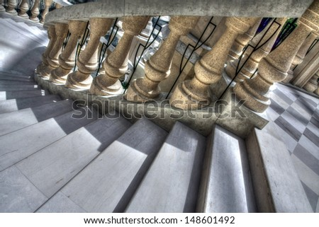 Stairs with golden pillars and checkered floor. - stock photo
