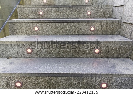 Stairs with lights in urban building - stock photo