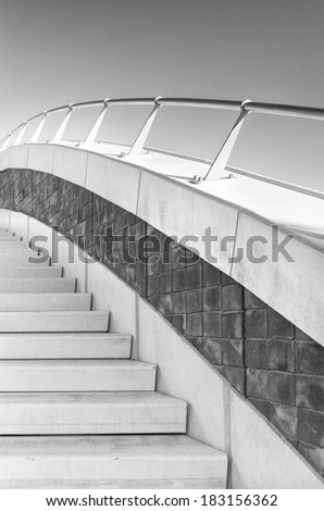 stairs with railing on a bridge in monochrome colors - stock photo