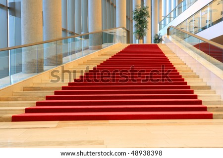 stairs with red carpet - stock photo