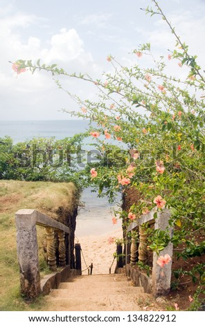 stairway entry to sandy beach with flowers Caribbean Sea Little Corn Island Nicaragua Central America - stock photo