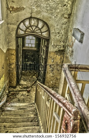Stairway in an abandoned and ruined building - stock photo
