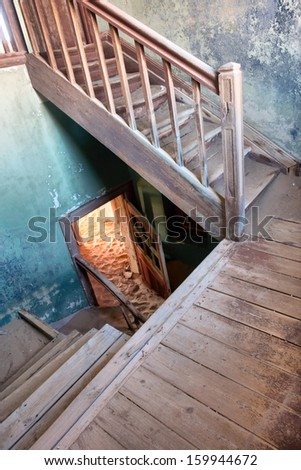 Stairway in the abandoned house. Shot in a ghost town, Namibia. - stock photo