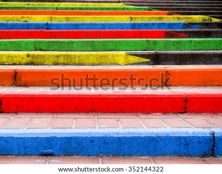 Stairway in the form of pencils of rainbow colors high contrasted - stock photo